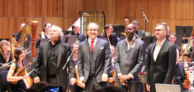 """If I wasn't a film composer, I'd have roadies to do all this for me."" David Arnold (second from left) curtsies to a standing ovation. He is joined left to right by Nicholas Dodd, David McAlmont, and Michael Price."